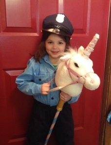 Riding a unicorn in uniform during Letter U week!